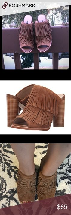 French Connection Uriah Fringed Mules Unworn. Get in the groove with the help of the boho beautiful fringed mules. Leather upper features fringe throughout. Easy slip-in wear. Peep toe. Man-made lining and footbed. Stacked heel. Man-made sole. Measurements: Heel Height: 4 in Weight: 13 oz Platform Height: 1 in. Size runs small in my opinion. I'm a 9 and this is a 9.5 and fit nicely. French Connection Shoes Mules & Clogs