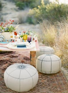 Moroccan poufs instead of chairs.