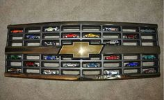 Chevy grill turned into matchbox cars shelf!