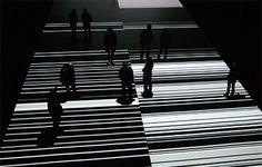 """Ryoji Ikeda is a Japanese sound artist who lives and works in Paris. Ikeda's music is concerned primarily with sound in a variety of """"raw"""" states, such as sine tones and noise, often using frequencies at the edges of the range of human hearing"""