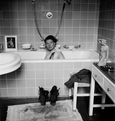 Lee Miller's stunning images of women in wartime: Lee Miller in Hitler's bathtub, Munich, Germany, 1945. Miller's friend David Scherman took this photograph (she took a similar one of him at the same time, but for obvious reasons, this is the better known), and it's very carefully staged, from the picture of Hitler on the tub to the slightly kitschy statue on the right, to the boots on the bathmat beside the tub. These are the boots Miller had worn to visit the concentration camp at Dachau.