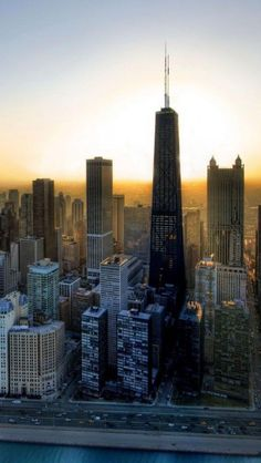 """Sunrise, Chicago, Illinois-i think needtobreathe wrote a song about basically this exact picture...""""when the daylight breaks through the buildings of chicago"""""""