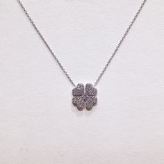 Silver and zircons necklace.
