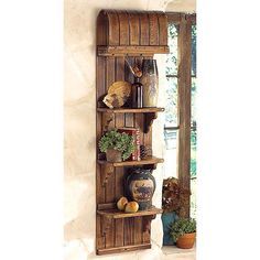 Use that old toboggan as a wonderful shelving unit. Great for the cottage.