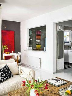 Un vano entre la cocina y el salón para que la luz natural ilumine la cocina