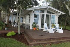 Great redesign of 70's house on the water.  This Old House reader remodel.