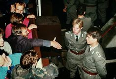 East German border policemen refuse to shake hands with a Berliner who stretches out his hand (1989)