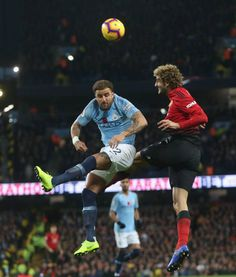 Marouane Fellaini of Manchester United in action with Kyle Walker of Manchester City during the Premier League match between Manchester City and... Manchester City, Manchester United, Kyle Walker, Premier League Matches, Action, The Unit, Style, Swag, Group Action