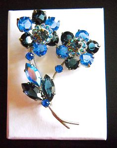 Exquisite blue rhinestone brooch stamped Czechoslovakia. It is 2-1/2 x 1-3/4 with dreamy and brilliant Czech rhinestones. The two flowers have