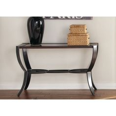 When it comes to contemporary decor, the Liberty contemporary metal and cherry sofa table combines just the right colors and metals to make a bold statement. Place this sofa table in your living room, and watch it become the main focus of the room.
