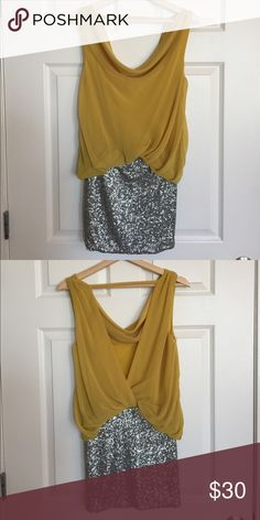 Yellow and sequence dress Yellow and glitter dress. The top part has a scoop neck in the front and is low in the back. The bottom is tight and sequence. Perfect for going out/clubbing or special occasions like NYE. This was bought at a small boutique! Mustard Seed Dresses Mini
