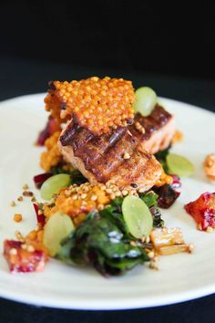 Crispy Salmon with Ruby Chard. This delicious crispy salmon with ruby chard giant couscous and grapes is a colourful treat thats not just healthy but also very pretty. Salmon Pasta, Trout Recipes, Salmon Recipes, Best Seafood Recipes, Chard Recipes, Weightwatchers Recipes, Tasty Dishes, Healthy Snacks, Gourmet