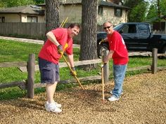 Charlie Vana and our loan officer Chuck Miceli spreading gravel for Maine Center during 2011 KW RED Day