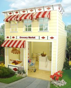 Playhouse Colors. This turn-of-the-century charmer, complete with awnings, is guaranteed to be the busiest place in town. Equipped with a checkout counter, produce bin, and merchandise shelves, the Grocery Market is a classic in every way.