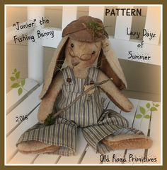 ***NEW*** pattern for Spring 2016 from Old Road Primitives ...Junior the Fishing Bunny ! Isn't Junior the cutest little bunny with his wire rimmed glasses and little stick fishing pole? Junior is hanging out at the pond, enjoying the lazy dayz of summer. Junior has a big slouch belly which fits perfectly his adorable bib overalls . The little top pocket of his bibs has been stuffed with a small hankie and a rusty ol' hook. Little Junior is super easy to