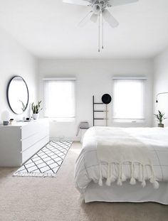 Get the minimalist look in your bedroom by keeping all decor monochromatic. With all white furniture and linens, you can achieve a clean and open look.