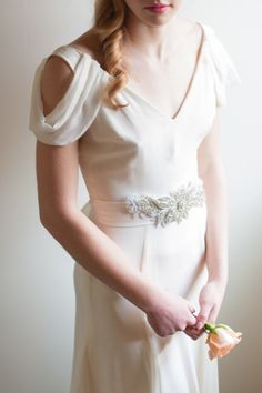 A chic gown for a stylish bride: http://www.stylemepretty.com/washington-weddings/seattle/2014/01/22/spanish-inspired-spring-bridal-shoot/ | Photography: Blue Rose - http://www.bluerosepictures.com/