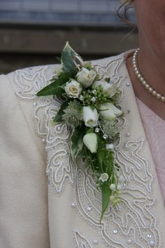 Corsage of tiny Ivory Rose buds with a touch of diamante sparkle to compliment her jacket