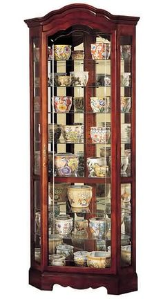 Howard Miller Jamestown Corner Curio Cabinet   Add Charm To Your Home And  Bring Notice To Your Collection With The Howard Miller Jamestown Curio  Cabinet.