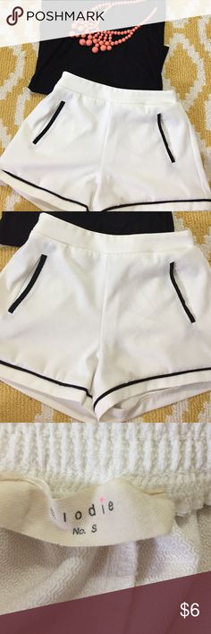 White and black shorts! Barely worn white with black lining shorts! Size small. Has pockets and in great condition! Shorts