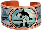 Handmade copper rings are silver plated and diamond cut in this colorful Alaskan wildlife jewelry killer whale ring design. The Whale, like the Wolf, stays with its family and travel in large pods. The Whale is a popular symbol for love and romance as they mate for life. He is said to protect those who travel away from home, and lead them back when the time comes.