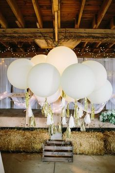 Giant geronimo white balloons with gold tassels for the barn reception! {@studio127}