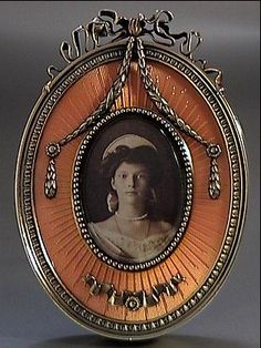 An antique Russian gilded silver and superb salmon pink guilloche enamel miniature picture frame by Carl Faberge's Moscow branch, made between 1899 and 1908.