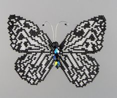 Create a stunning Paper Kite butterfly using this 6 page beading pattern and tutorial in pdf format that includes text, photos and illustrations. Using delica cylinder beads, fire polished beads and brick stitch, the finished Paper Kite Butterfly will be 3 1/2 inches wide (9 cm) at its widest point and 2 5/8 inches high (6.8 cm) and may be incorporated into a piece of finished jewelry as you like. To open the file, you will need software that reads pdf format such as Adobe Acrobat Reader…
