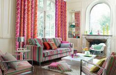 I love the striped couch with the pattern of the curtains. NEVER be afraid of mixing patterns or stripes!