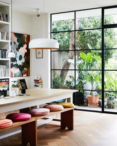 A huge bay window overlooking the lush garden and multicolored round cushions. Une immense baie vitrée sur le jardin luxuriant et des coussins ronds multicolo… Huge bay window overlooking the lush garden and multicolored round cushions. Dining Room Colors, Dining Room Lighting, Dining Room Design, Dining Room Bench, Colorful Dining Rooms, Cosy Dining Room, Dining Room Windows, Nook Table, Casual Dining Rooms