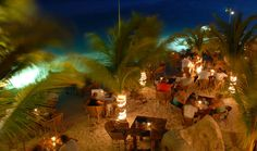 Flying Fishbone - dine right on the beach, toes in the sand, under swaying palm fronds along a perfect little crescent bay in Savaneta, Aruba's charming fisherman's town.