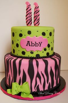 11th birthday cake~ pink with zebra stripes and green with cheetah spots.