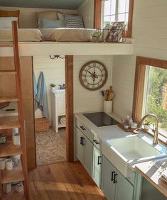 LOVE the colors. The kitchen has a white apron sink, electric cooktop, and wine cooler. Next to the kitchen counter is a bar height table and two bar stools. Tyni House, Tiny House Loft, Tiny House Living, Tiny House Plans, Tiny House Design, Tiny House On Wheels, Cottage Design, Tiny Spaces, Little Houses