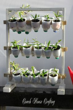 For another take on repurposing milk jugs, build a tiered planter. It doubles as a space-saving garden solution that will look at home in any greenhouse.