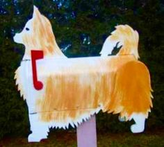Chihuahua mailbox - Handcrafted and hand painted animal mailboxes by artist Michel Devost in Quebec. If you would like to order a special mailbox, contact Michel at http://pages.globetrotter.net/miche/mailboxes.html