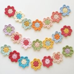 """""""These are super simple 3 round flowers. You can use them to make a garland or a bunting. You can join them together to make a scarf, shawl or blanket. This a perfect project to use up odd bits of yarn leftover from other projects."""""""