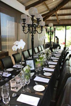 black 9 arm candelabra with white phalaenopsis orchids on black table linen #black candleabra #black and white wedddings #white phalaenopsis orchid #crystal weddings  www.decorit.com.au