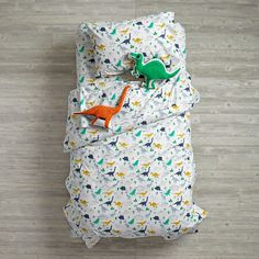 How old-school are we? We were into reptiles before they were cool. In fact, they used to be called dinosaurs. And this exclusive dinosaur duvet is covered with printed dinos, and makes the perfect addition to our Retro Reptile Bedding set.<br /><br /><NEWTAG/><ul><li>Nod exclusive</li><li>A Bikini Sous la Pluie</li><li>Printed</li><li>200-thread count cotton percale</li><li>Duvet has a hidden button closure</li><li>Available in Twin and Full-Queen</li></ul><h2>Show 'em what you're made…