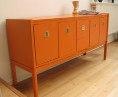 fab vintage sideboard painted orange  Again I love the clean lines of this one. I could do with another color though.   My place is getting so girly that I need some less frou frou pieces to balance it out.