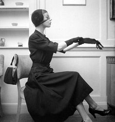 3-1-12  The little black dress to wear year-round by Rembrandt, Vogue, February 1950