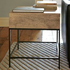 I love this for a side table because of the roomy drawer. You can hide your retainer in there and no one will ever be the wiser. Rustic Storage Side Table - Raw Mango | West Elm