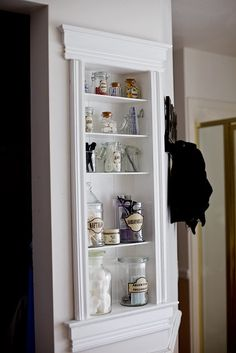 Removing drywall and putting in a handy storage shelf. Another good idea if space is sort of tight and you want to display things instead of using a curio cabinet. You could add a door/doors if you wanted the items protected.
