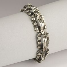 Hector Aguilar sterling silver wave and bead bracelet