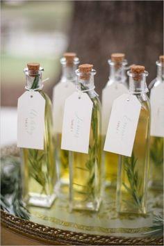 Bottled olive oil as escort cards and wedding favors #wedding #diywedding #gardenparty #weddingfavors #escortcards