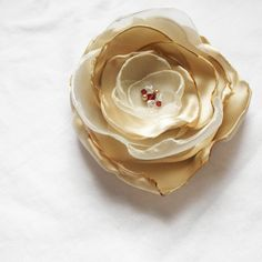 White/Champagne Flower in Organza and Satin Swarovski Crystal Wedding Fascinator. $15.00, via Etsy.