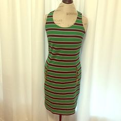 Michael Kors dress Michael Kors green and navy striped. Gold hardware with zippers. Worn twice !!! Has a small area where there is a snag-see photo. Michael Kors Dresses