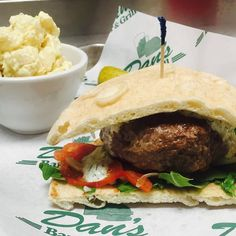 The Gyro Burger stuffed with feta and havarti cheese, topped with house made tzatziki sauce, marinated onions and tomatoes served on a warm pita at Dan's Bar & Grill, 8485 240th St E., New Trier, Minnesota.