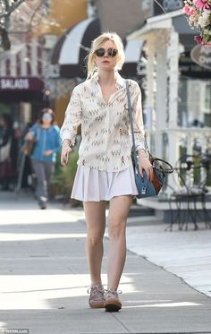 Ensemble: The Maleficent star was spotted in a relaxed shirt covered with soldiers, which ...