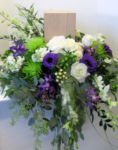 flowers around a funeral urn - Google Search