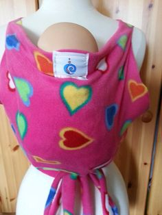 UCHI kangaroo vest used the worn backwards, great support, access to lines, easy to use, ideal for micro-preemies (however doll is 5 lbs). contact through website contact form http://www.uchimama.net